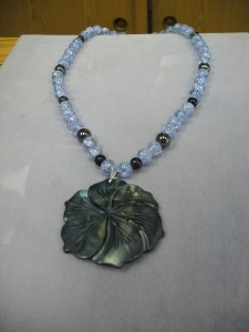 Custom Made Jewellry = 3. 1235- This is an unbelievable combination of 8mm round Blue-Violet crackle glass, Hematite, Blue goldstone beads make the large carved Mother of Pearl flower jump to life. It is so gorgeous and lively.