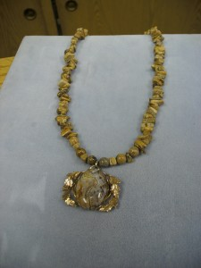 """1243- This is a Picture of Jasper round and chip bead necklace with a large oval Picture Jasper set in a fancy gold filled frame. Wonderful with any shade of browns, oranges, or beige. People will ask, """"What are those beads""""."""