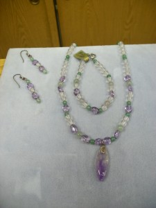 This is a Jade, Amethyst, and Rock crystal frosted bead necklace with a freeform Amethyst drop.  There are matching drop pierced earrings and bracelet completing this set.  So bright and cheerful and can be worn with just about anything. Everything is in Sterling Silver.